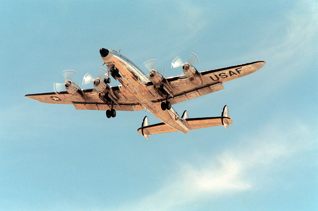 """The former U.S. Air Force Lockheed VC-121A Constellation (s/n 48-610) flies over Davis-Monthan Air Force Base, Arizona (USA), as it departs on its way to a private company for further restoration work on 24 October 1990. The aircraft had already undergone restoration at the Aerospace Maintenance and Regeneration Center at Davis-Monthan AFB after being kept in storage for over 20 years. 48-610 served as Dwight D. Eisenhower's presidential aircraft """"Colombine II"""" from January 1953 to November 1954 until replaced by the """"Colombine III"""" VC-121E. Since 1989 it is privately owned (civil registration N9463). (Photo TSgt. Ron Woods, USAF)"""