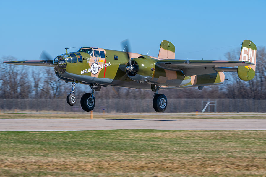 "The Experimental Aircraft Association's North American B-25 Mitchell ""Berlin Express"" on its first post-restoration flight. (Photo © EAA)"