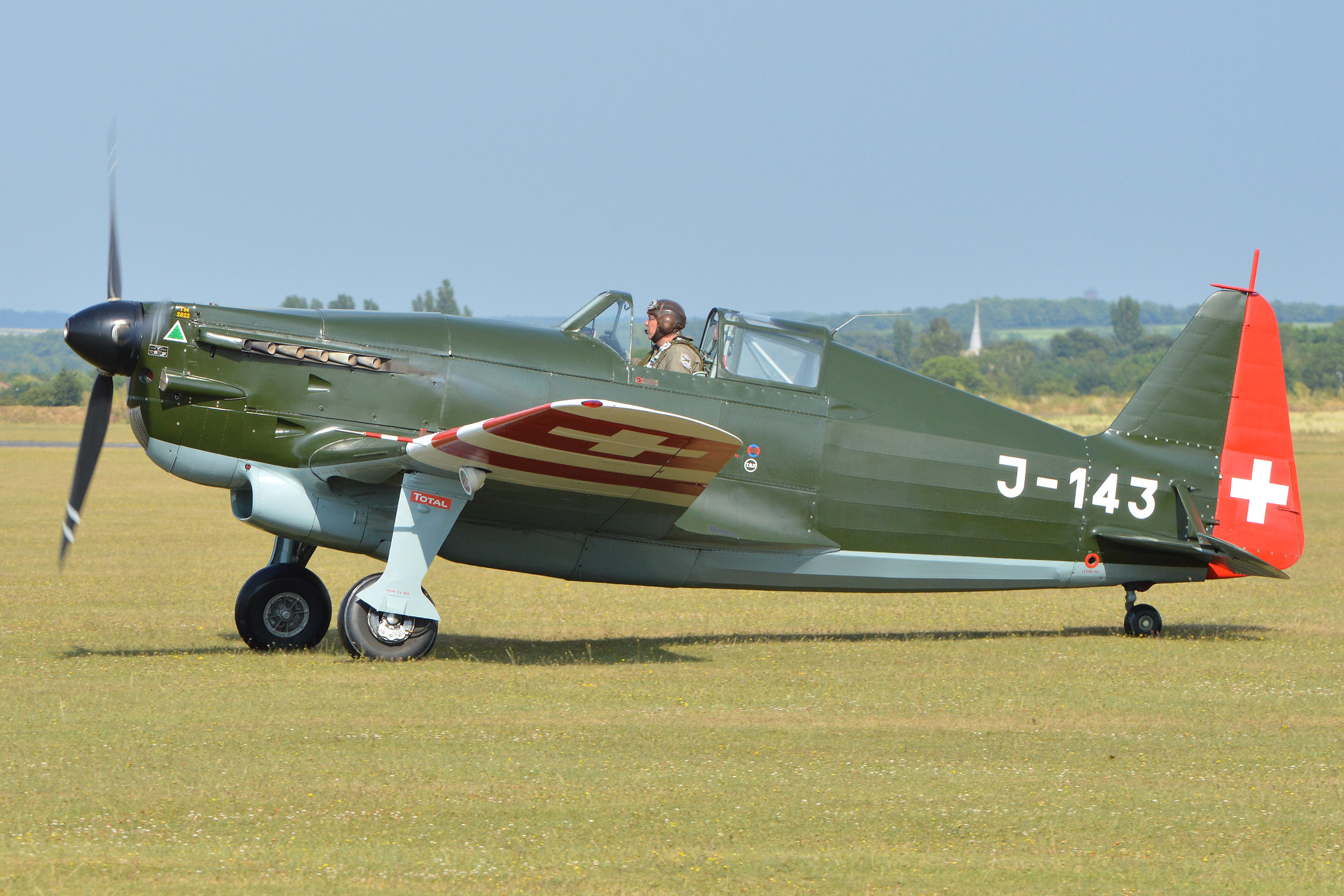 Daniel Koblet at the controls of the Morane-Saulnier D-3801 (MS.406) HB-RCF at Duxford in 2015 (Photo Alan Wilson (CC BY-SA 2.0))